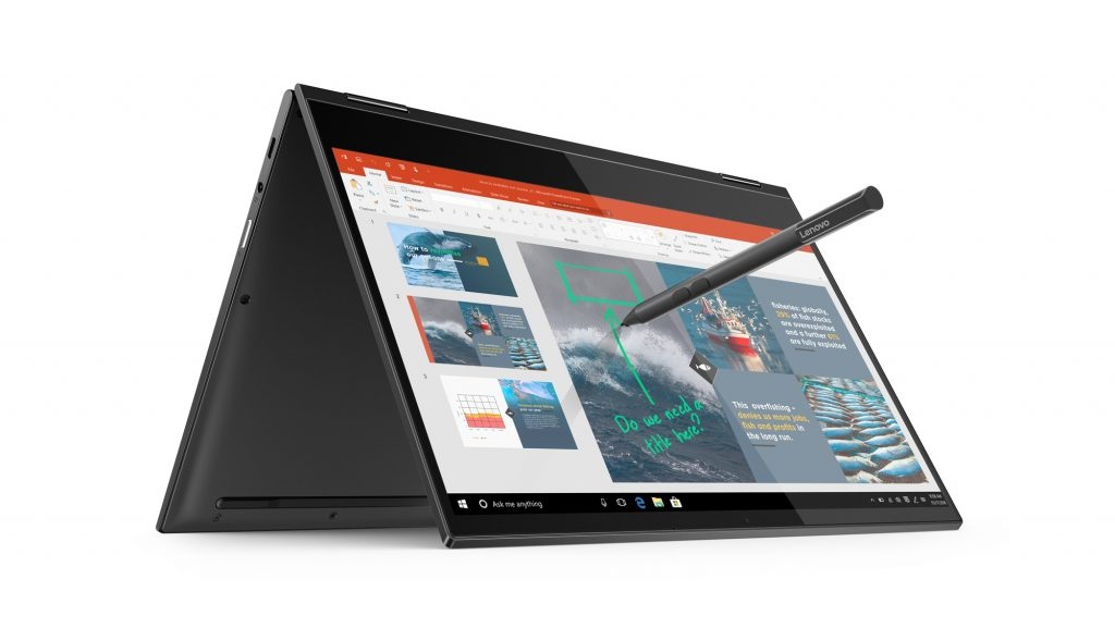 Lenovo Yoga Book C630 open, inverted with digital pen hovering over screen, marking it up