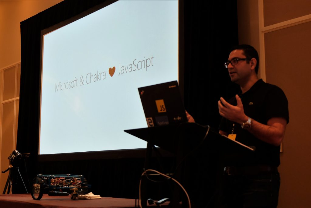 Photo of Gaurav Seth on stage at JSConf US Last Call announcing ChakraCore