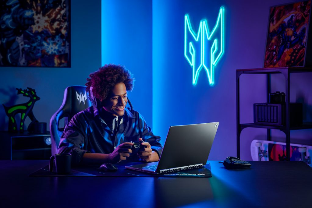 Gamer sitting in a dimly lit room in front of Acer Predator Triton 500 SE